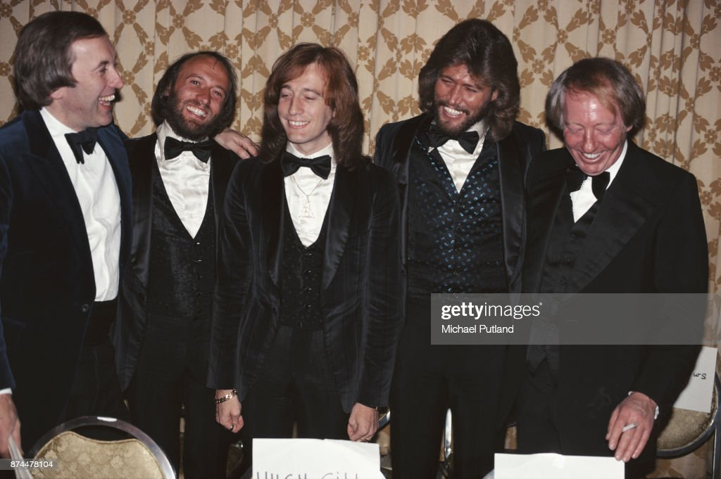 Pop vocal trio The Bee Gees with Australian music entrepreneur Robert Stigwood (1934 - 2016) and English television host and entertainer David Frost, after receiving the annual Superstars award given by the Police Athletic League for charity work, at the Sheraton Center, New York City, 8th January 1979. The group are being honoured for the benefits they played in aid of the PAL.