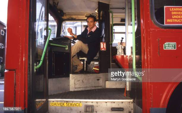 Pop Will Eat Itself drummer Fuzz Townshend at the wheel of a London United MCW Metrobus used for driver training, London, 1996. Townshend later went...