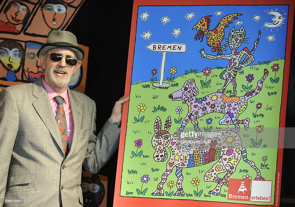 US pop-artist James Rizzi poses next to a poster designed by him during a press preview of the exhibition 'Rizzi's World' on May 20, 2010 in Bremen, northern Germany. From May 21 to July 4, 2010, the Messehallen Bremen present a retrospective with more than 1,200 works of the artist.