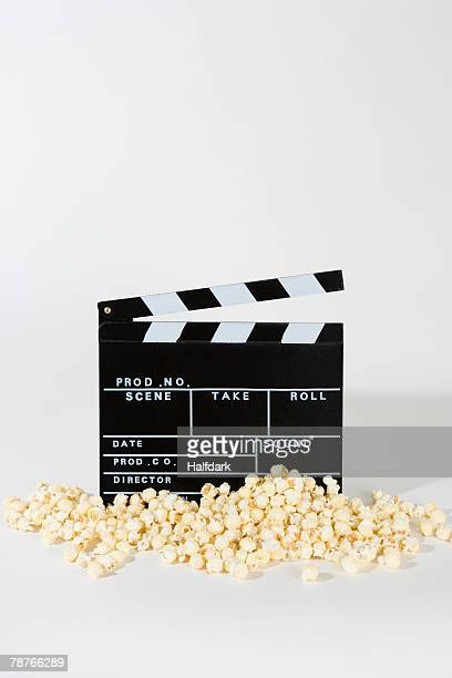 Popcorn and a movie clapperboard