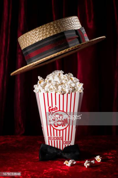 popcorn and hat - ian gwinn stock photos and pictures