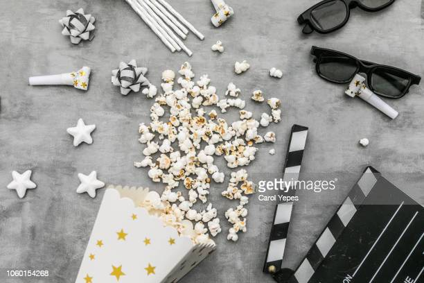 popcorn boxes , 3d glasses, clapper board, on bright background - arts culture and entertainment stock pictures, royalty-free photos & images