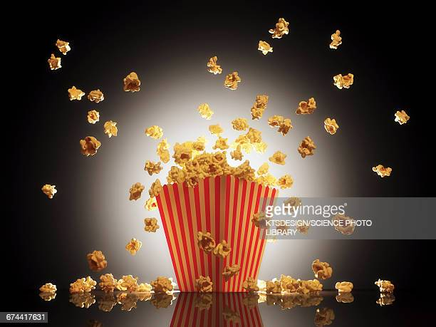 popcorn exploding from bucket - popcorn stock pictures, royalty-free photos & images