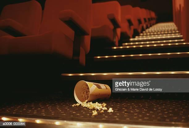 popcorn in theater aisle - 映画館 ストックフォトと画像