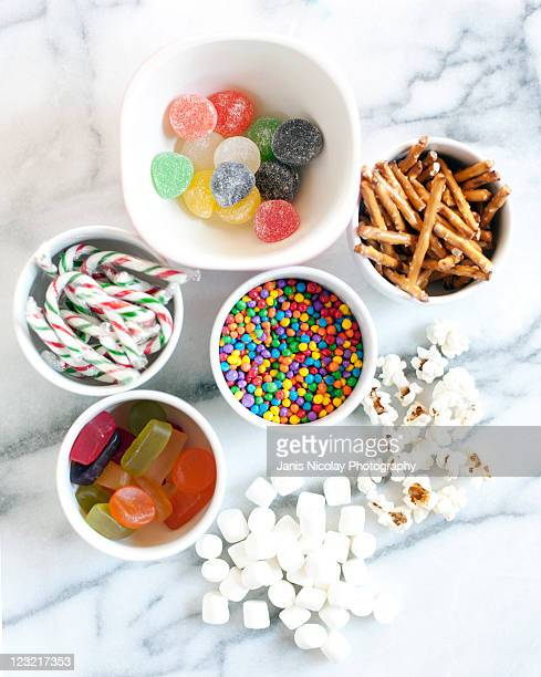 popcorn snowmen decorations - bowl of candy stock photos and pictures