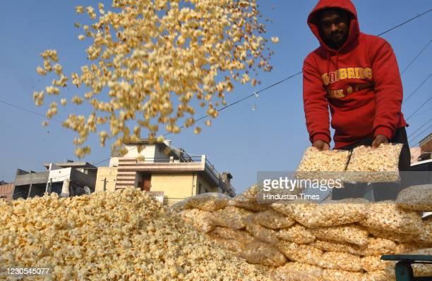 Popcorn vendor at work ahead of Lohri festival, on January 11, 2020 in Patiala, India.