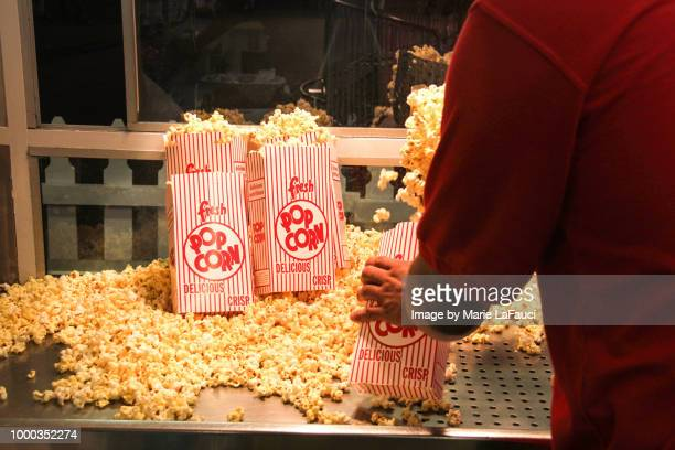 popcorn vendor inside a concession stand - one night stand stock-fotos und bilder