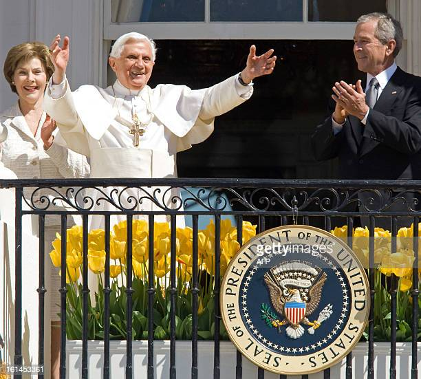 Pope Benedict XVI acknowledges the crowd as US President George W Bush and First Lady Laura Bush look on during welcoming ceremonies April 16 2008 in...