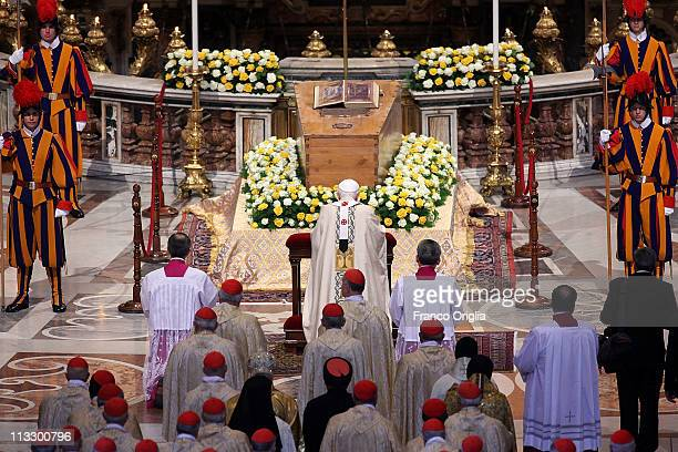 Pope Benedict XVI and cardinals pray in front of the coffin of John Paul II at St Peter's Basilica at the end of John Paul II Beatification Ceremony...