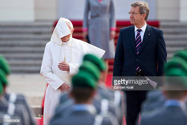 Pope Benedict XVI and German President Christian Wulff reviews a guard of honour upon his arrival at Schloss Bellevue palace on September 22 2011 in...