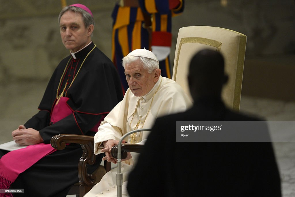 Pope Benedict XVI (C) and his personal secretary Georg Gaenswein take place for the pontif's weekly general audience on January 30, 2013 at the Paul VI hall at the Vatican.