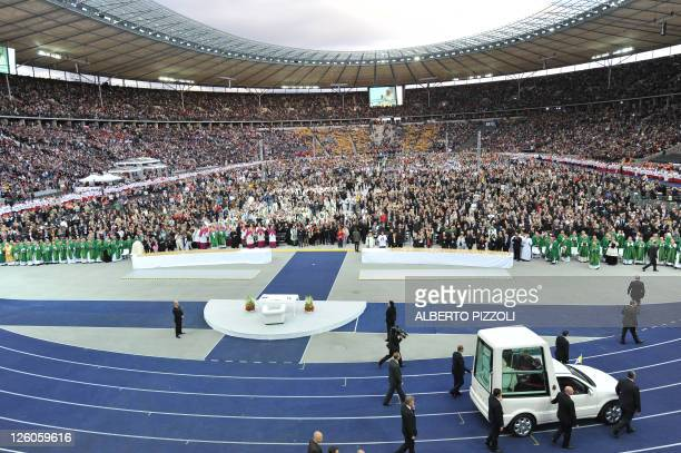Pope Benedict XVI arrives at the Olympic stadium in Berlin on September 22, 2011 in the Pope mobile to give a mass on the first day of his first...