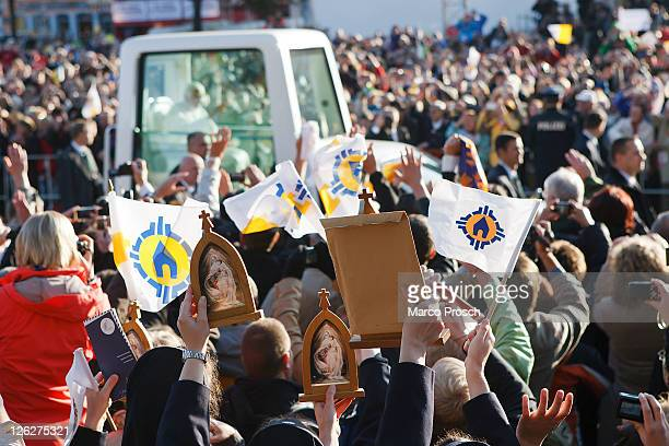 Pope Benedict XVI arrives in his popemobile to lead a morning mass at Domplatz square in front of the Erfurter Dom cathedral on September 24 2011 in...