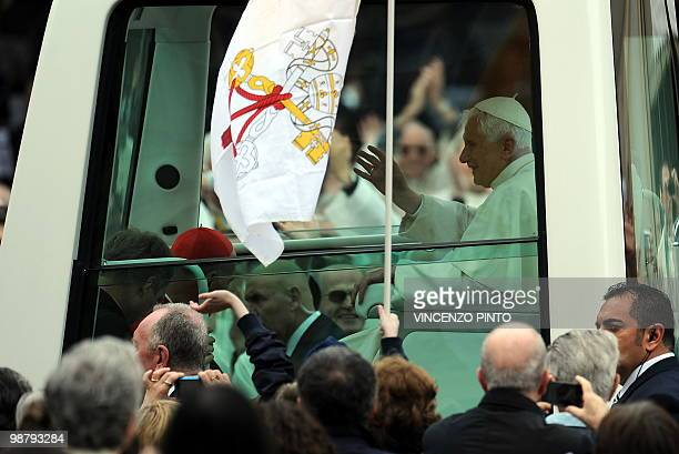 Pope Benedict XVI arrives in the popemobile to celebrate a mass at San Carlo square in central Turin on May 2, 2010. Pope Benedict XVI will bow...