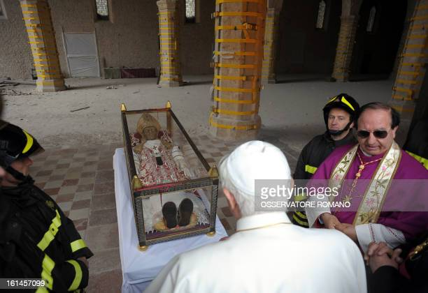 Pope Benedict XVI arrives to cover the relic of Pope Celestine V with a stole during his papal visit at St Maria of Collemaggio church collapsed on...