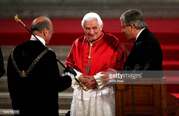 Pope Benedict XVI arrives with Speaker of the House John Bercow and Black Rod at Westminster Hall on September 17, 2010 in London, United Kingdom....