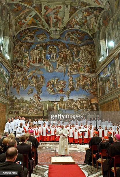 Pope Benedict XVI attends a concert by the Regensburger Domspatzen boys choir at the Sistine Chapel on October 22 2005 in Vatican City The choir...