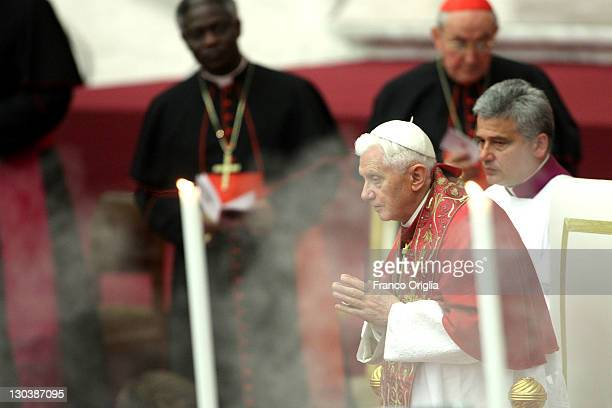 Pope Benedict XVI attends a prayer in preparation for the meeting in Assisi at the Paul VI Hall on October 26 2011 in Vatican City Vatican Tomorrow...