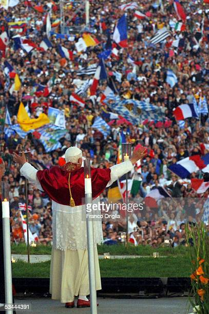Pope Benedict XVI attends a vigil at the Marienfeld on the eve of World Youth Day Mass on August 20, 2005 in Cologne, Germany. Hundreds of thousands...