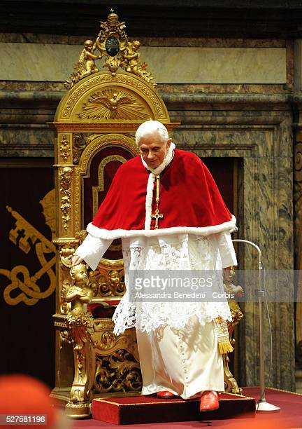 Pope Benedict XVI attends an audience with the Roman Curia for Christmas greetings in the Sala Clementina of the Apostolic Palace in Vatican City...