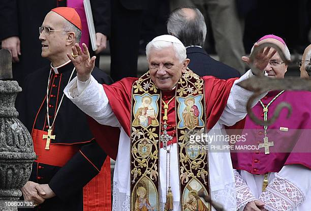 Pope Benedict XVI blesses faithful flanked by Vatican secretary of State Tarcisio Bertone and Santiago's archbishop Julian Barrio at the Santiago de...