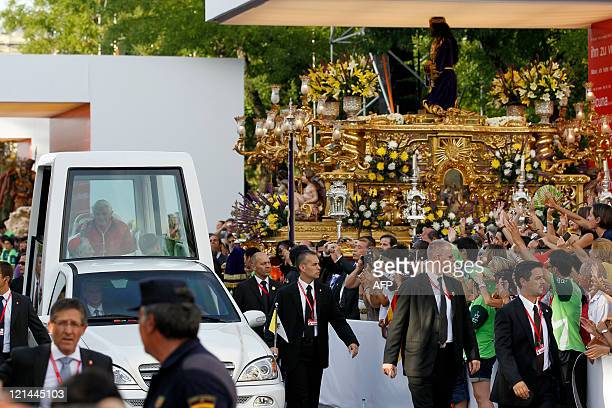 Pope Benedict XVI blesses faithful from his popemobile ahead of the Via Crucis a 700meterslong Way of the Cross between Plaza de Cibeles and Plaza de...