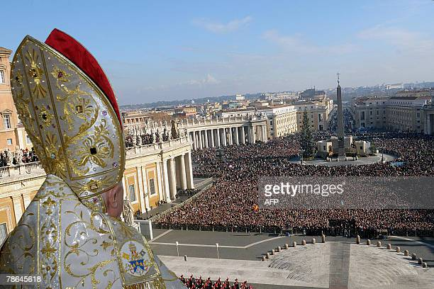 Pope Benedict XVI blesses pilgrims gathered in St Peter's Square during his traditional Christmas blessing Urbi et Orbi 25 December 2007 The pontiff...