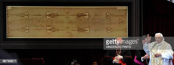 Pope Benedict XVI blesses the audience in front of the Shroud in the Turin cathedral on May 2 2010 Pope Benedict XVI will bow before the Shroud of...