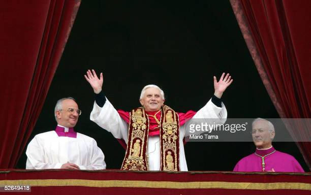 Pope Benedict XVI Cardinal Joseph Ratzinger of Germany waves from a balcony of St Peter's Basilica in the Vatican after being elected by the conclave...