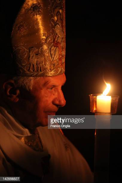 Pope Benedict XVI carries the Paschal candle as he leads the Ceremony of the Light during the Holy Saturday Easter vigil mass at St Peter's Basilica...