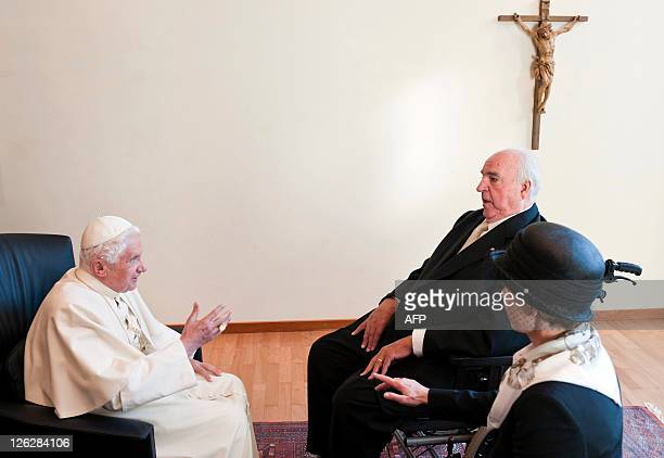 Pope Benedict XVI chats with Former German chancellor Helmut Kohl and his wife Maike Richter-Kohl during a seminary in Freiburg, southern Germany, on...
