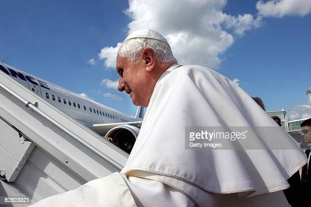 Pope Benedict XVI climbs the steps of an Air France jet as he begins his return journey to the Vatican September 15 2008 following a four day...