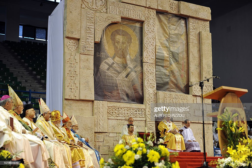 Pope Benedict XVI (2R) conducts mass at the Eleftheria Sports Centre in Nicosia on June 6, 2010 on the third and final day of the pontiff's visit to the mostly Greek Orthodox Mediterranean island of Cyprus.