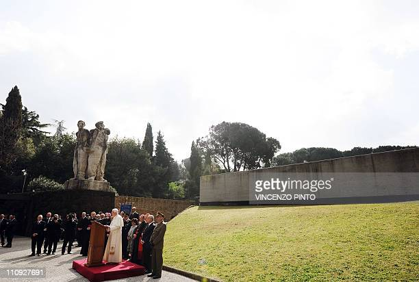 Pope Benedict XVI delivers a speech during his visit to the Fosse Ardeatine site on March 27 2011 in Rome where 335 Italians including Catholics and...