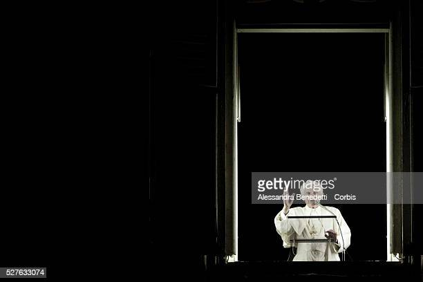 Pope Benedict XVI delivers a speech from his appartment to faithful gathered at St Peter's square after a torchlit procession going along the main...