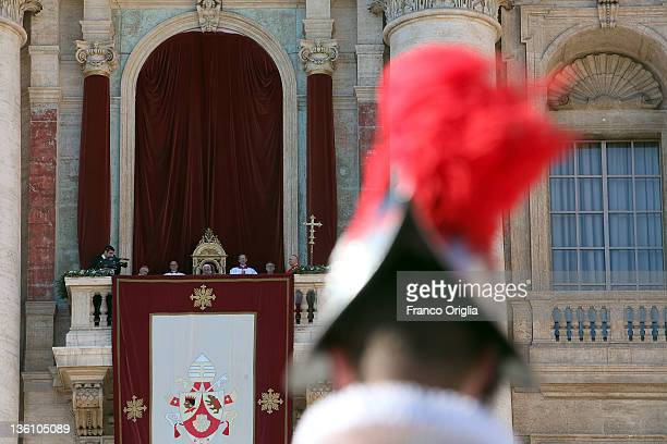 Pope Benedict XVI delivers his Christmas Day message 'urbi et orbi' blessing from the central balcony of St Peter's Basilica on December 25 2011 in...