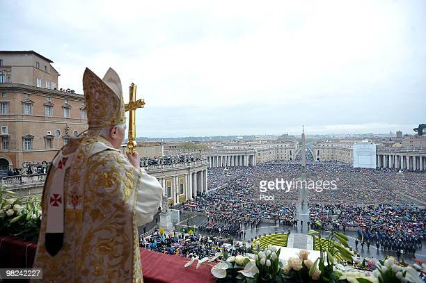 Pope Benedict XVI delivers his Easter 'Urbi et Orbi' blessing from the central balcony of St Peter's Basilica on April 04 2010 in Vatican City...