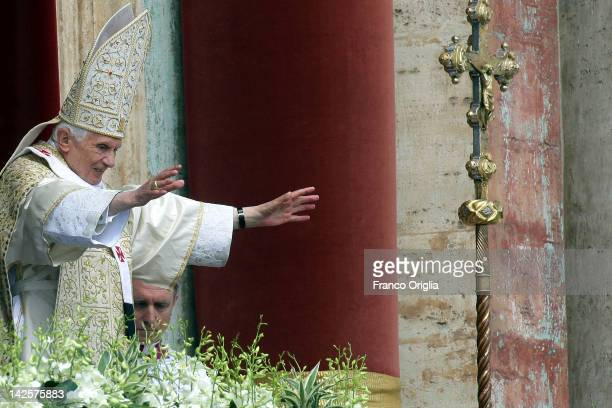 Pope Benedict XVI delivers his 'Urbi et Orbi' message and blessing from the central balcony of St Peter's Basilica at the end of the Easter Mass on...