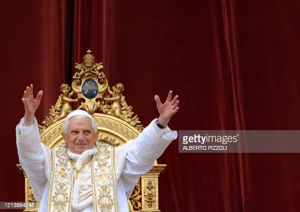 Pope Benedict XVI delivers the traditional Urbi et Orbi Easter message from the central loggia of St Peter's Basilica on April 12 2009 at the Vatican...