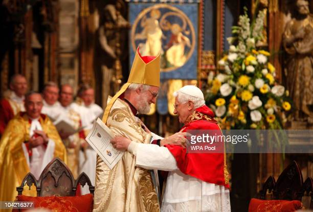 Pope Benedict XVI embraces with the Archbishop of Canterbury Dr Rowan Williams in Westminster Abbey during a service of evening prayer on September...