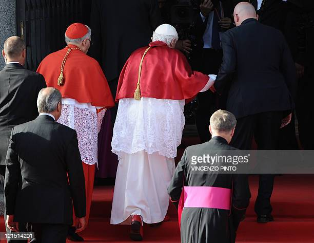 Pope Benedict XVI enters the Almudena Cathedral prior to celebrating a mass during the World Youth Day festivities in Madrid on August 20 2011 The...