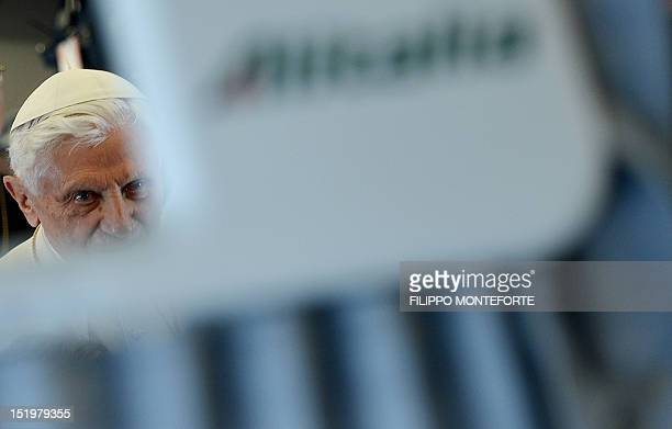 Pope Benedict XVI enters the plane as he starts his trip from Rome's Ciampino airport to the Lebanese capital Beirut on September 14 2012 The pope...