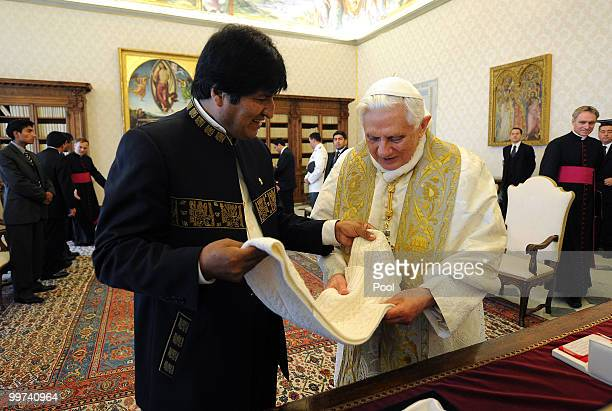 Pope Benedict XVI exchanges gifts with President of Bolivia Evo Morales during a meeting at the Vatican Library on May 17 2010 in Vatican City...