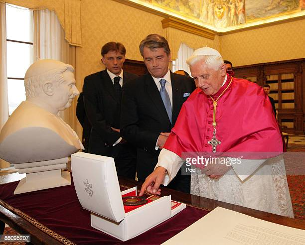 Pope Benedict XVI exchanges gifts with Ukrainian President Victor Yushchenko during their meeting at his private library on June 1, 2009 in Vatican...