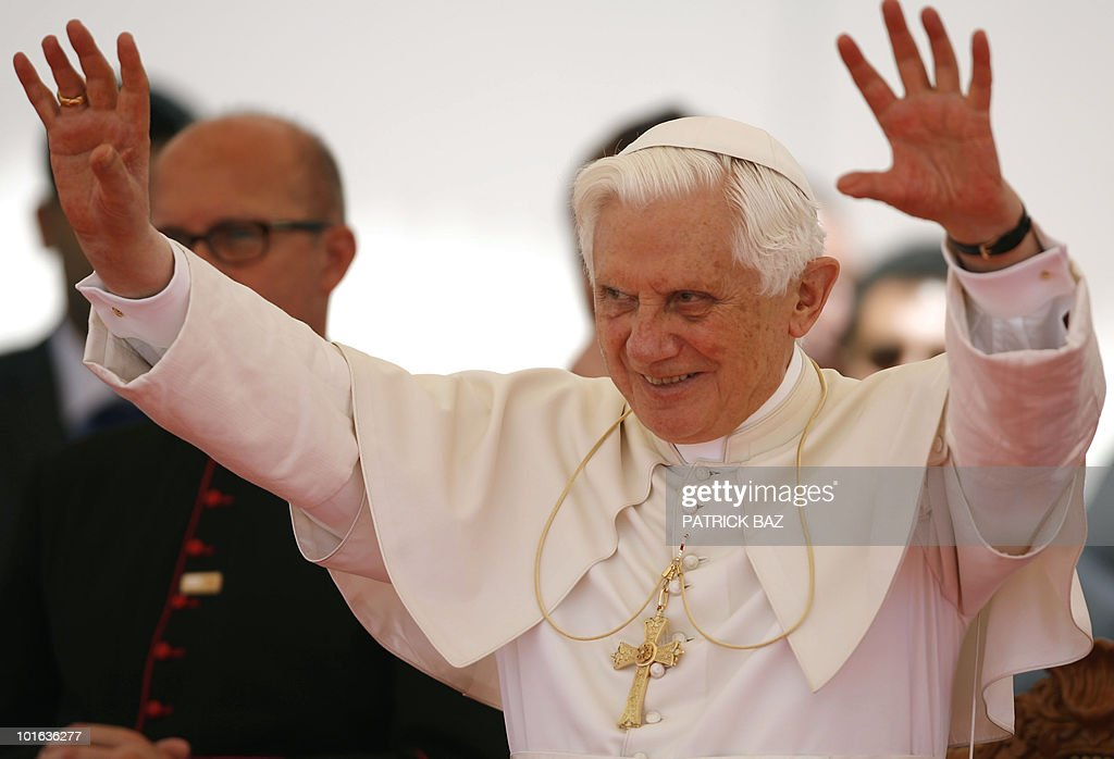 Pope Benedict XVI gestures to the crowd as he attends a gathering with the small Cypriot Catholic community at a Maronite elementary school in Nicosia on June 5, 2010 on the second day of the pontiff's visit to the mainly Greek Orthodox Mediterranean island.