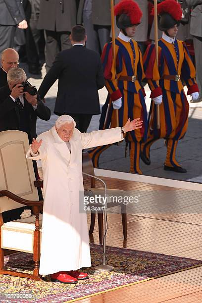 Pope Benedict XVI gestures to the crowd in St Peter's Square on February 27 2013 in Vatican City Vatican The Pontiff has attended his last weekly...