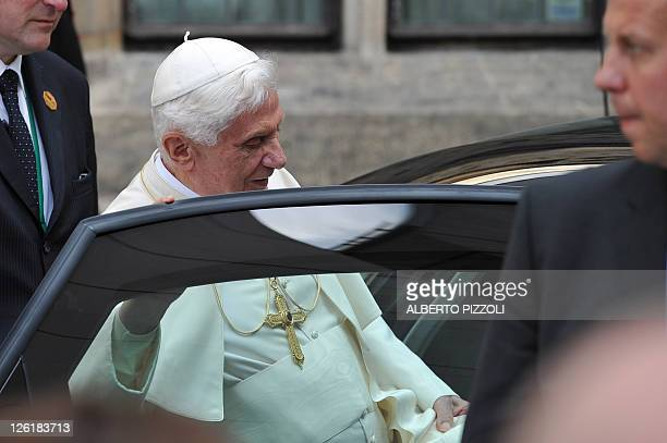 Pope Benedict XVI gets into his car as he leaves the protestant monastery of St. Augustin in Erfurt, eastern Germany, on September 23 on the second...