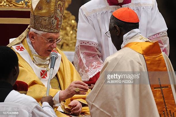 Pope Benedict XVI gives his cardinal ring to Guinean Robert Sarah during the Eucharistic celebration with the new cardinals on November 21, 2010 at...