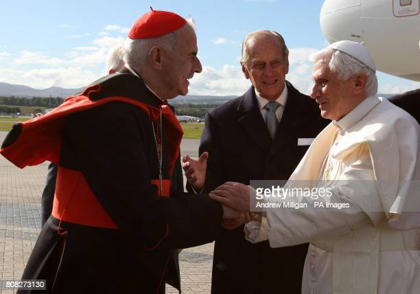 Pope Benedict XVI greets Cardinal Keith O'Brien as he arrives in Edinburgh, Scotland, to begin the first papal state visit to the UK.