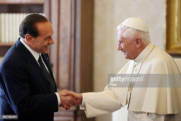 Pope Benedict XVI greets Italian Prime Minister Sivio Berlusconi during their meeting November 19 2005 in Vatican City This is the first meeting...